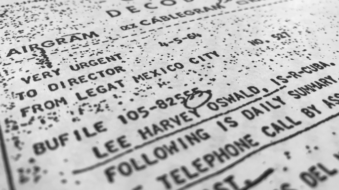 Part of a file, dated April 5, 1964, details efforts to trace Lee Harvey Oswald's travel from Mexico City back to the United States. (Credit: Jon Elswick/AP Photo)