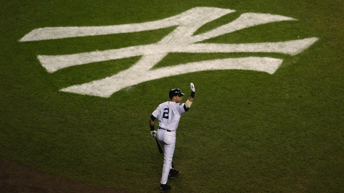 Derek Jeter of the New York Yankees walking to the plate  in the seventh inning of game two of the Major League Baseball World Series, 2003. (Credit: Jed Jacobsohn/Getty Images)