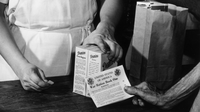 In an effort to ration sugar, coupons from the War Ration Books assured a just distribution of the nation's sugar supply to all, July 1942. (Credit: Anthony Potter Collection/Getty Images)