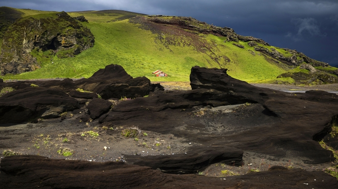 View of a red little house on a lava field near Vik, south of Iceland. (Credit: Joel Saget/AFP/Getty Images)