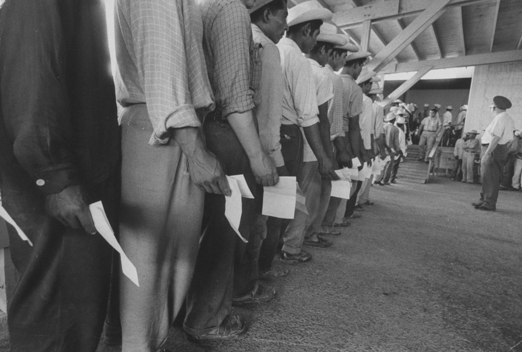 Mexican migrant farm workers lined up for job interviews and to sign contracts at reception center. Until the mid-20s, the growth of the Mexican population in the United States had been attributed mainly to immigration of men looking for work. But with the increased arrival of Mexican women, restrictionists began to focus on birth rates among the immigrant population.
