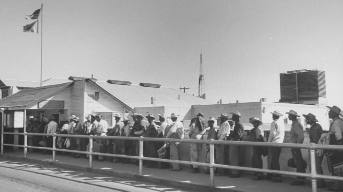 Migrant Mexican workers standing in line at the U.S. Public Health Station. The notion that Mexicans overburden the government, particularly in health, education and welfare, drove legislation to repatriate, and in some cases, sterilize immigrants. (Credit: Bernard Hoffman/The LIFE Picture Collection/Getty Images)