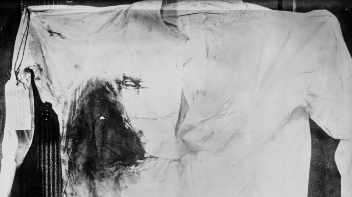 Bloodstained shirt worn by President Theodore Roosevelt, photographed following an assassination attempt in Milwaukee, Wisconsin, 1912. (Credit: Harlingue/Roger Viollet/Getty Images)