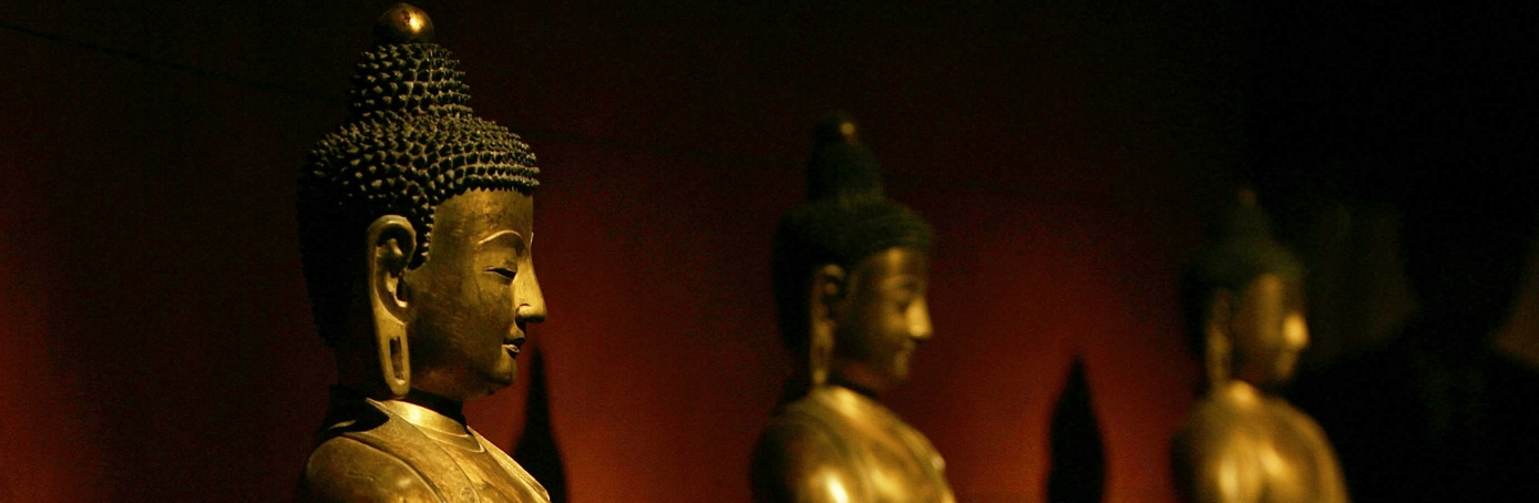 Ancient Buddhist statues displayed at the Capital Museum in Beijing, China. (Credit: Cancan Chu/Getty Images)