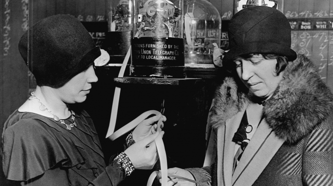 Two women read ticker-tape in a stock broker's office in St. Paul, Minnesota, 1929. (Credit: Minnesota Historical Society/CORBIS/Corbis via Getty Images)