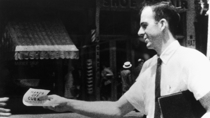 Lee Harvey Oswald distributes Hands Off Cuba flyers on the streets of New Orleans, Louisiana. This photograph was used in the Kennedy assassination investigation. (Credit: Corbis via Getty Images)