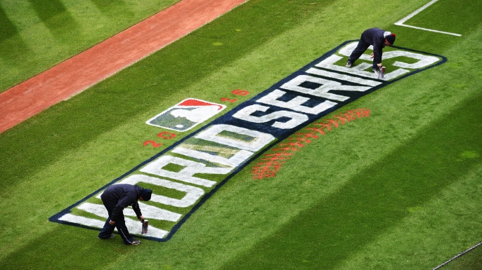 Members of the Cleveland Indians grounds crew paint the World Series logo on the field prior to Media Day at Progressive Field, Cleveland, Ohio. (Credit: Jason Miller/Getty Images)