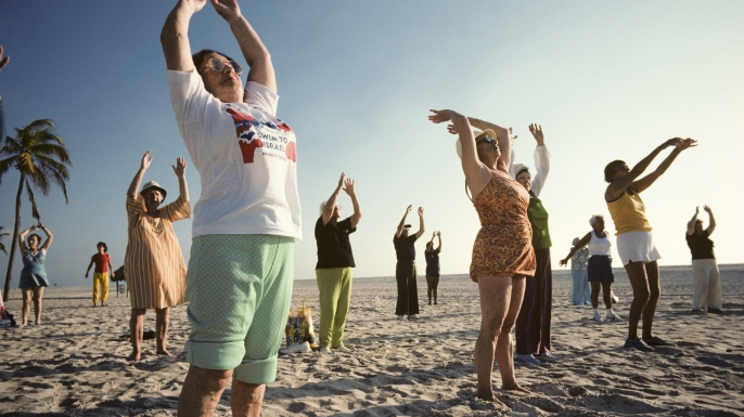 Elderly people doing outdoor early morning exercises in a class on Miami Beach. (Credit: Nathan Benn/Corbis via Getty Images)