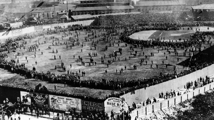 The crowd pouring onto the field at Huntington Avenue Grounds in Boston following the opening game of the 1903 World Series between the Red Sox and Pittsburgh Pirates. (Credit: Mark Rucker/Transcendental Graphics, Getty Images)