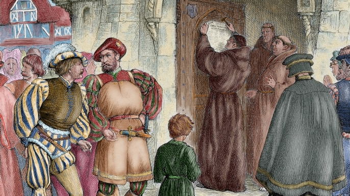 Martin Luther nailing his 95 theses to the door of the Wittenberg Castle Church. (Credit: Prisma/UIG/Getty Images)