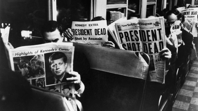 Commuters reading of John F. Kennedy's assassination, 1963.  (Credit: Carl Mydans/The LIFE Picture Collection/Getty Images)