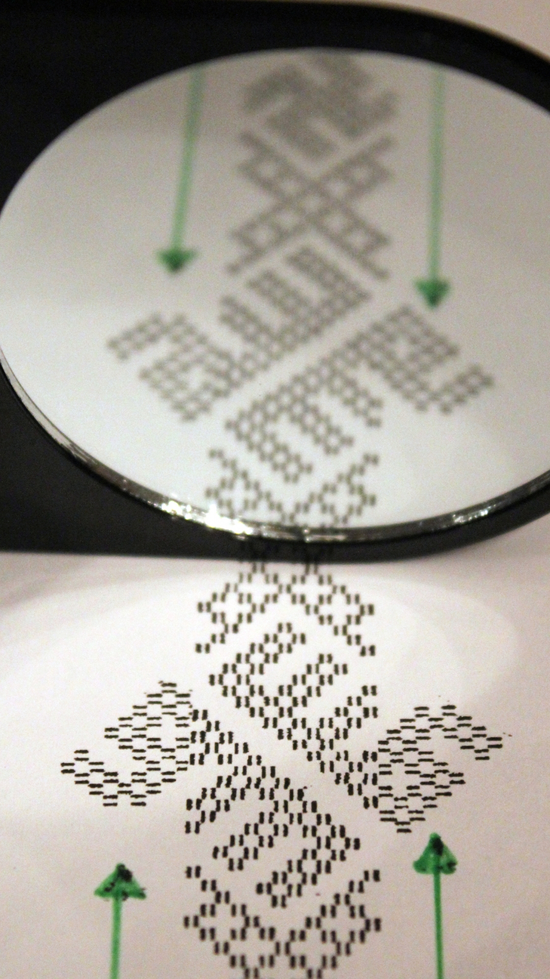 """An enlarged print of the woven band's pattern reveals """"Allah"""" in it's reflection. (Credit: Annika Larsson)"""