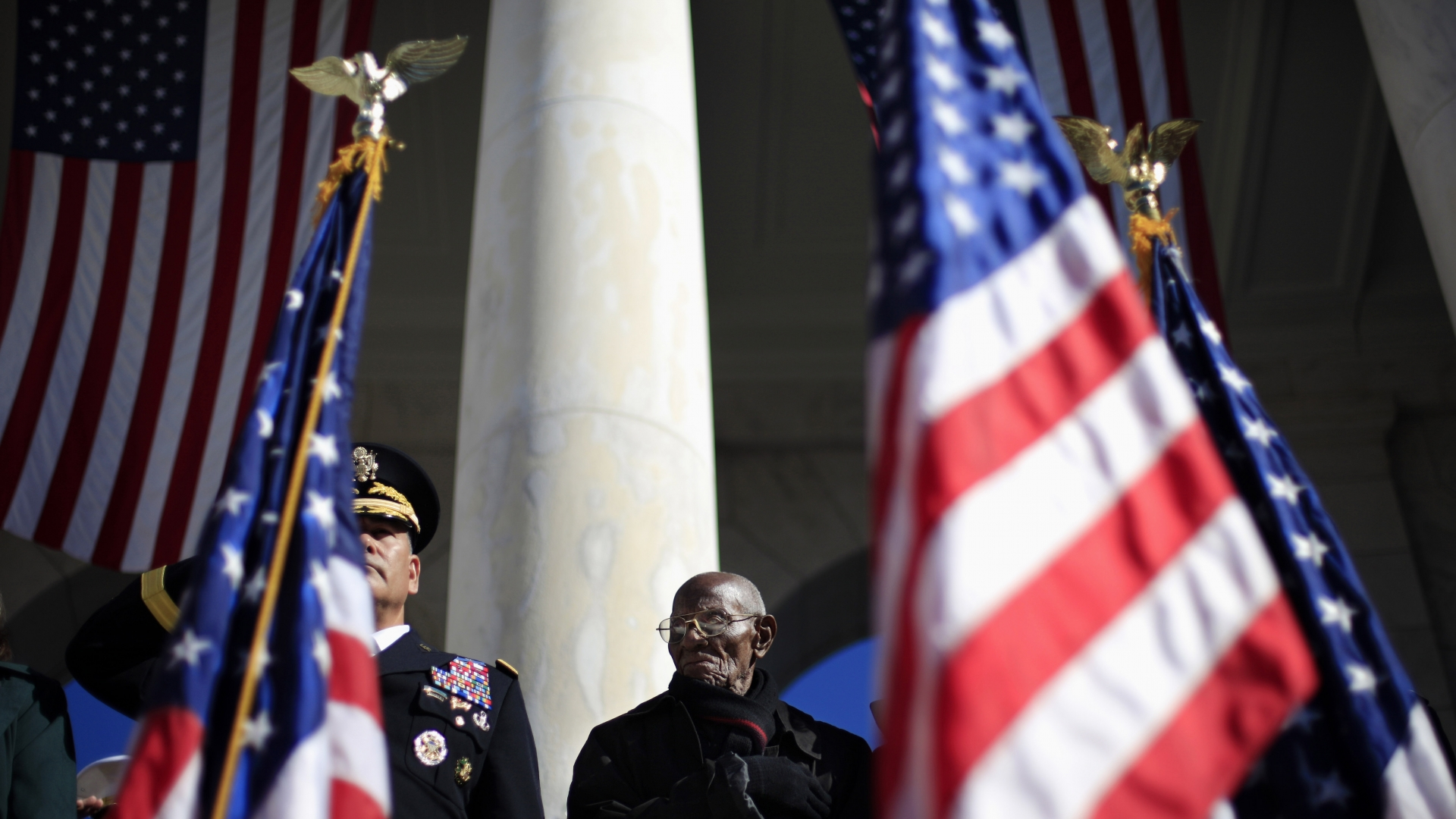 World War II veteran, Richard Overton, standing for the presentation of the colors during Veteran Day ceremony in the Arlington National Cemetery Amphitheater, 2013. (Credit: Pablo Martinez Monsivais/AP Photo)