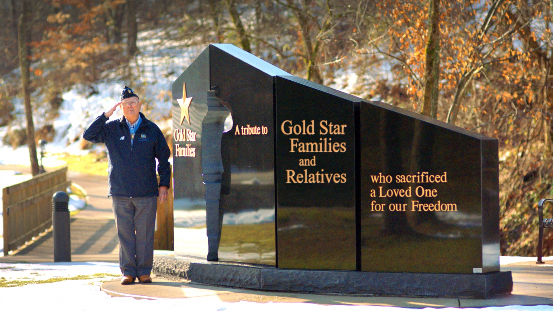 "Hershel ""Woody"" Williams saluting next to the Gold Star Families Memorial Monument. This monument is to honor Gold Star Families, preserve the memory of the fallen, and stand as a stark reminder that Freedom is not free. (Courtesy of the Hershel Woody Williams Medal of Honor Foundation)"