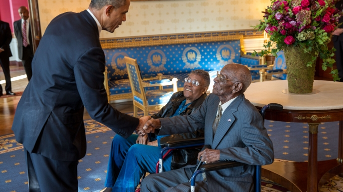 President Barack Obama greets Richard Overton, with Earlene Love-Karo, before attending a Veteran's Day Breakfast at the White House, 2013. (Credit: 506 Collection/Alamy Stock Photo)