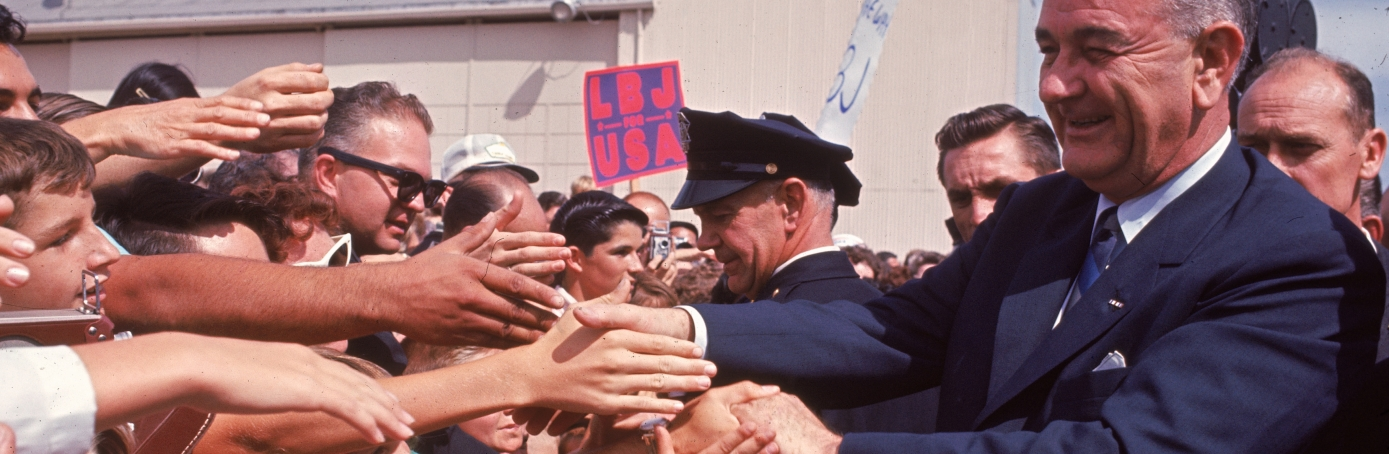 President Lyndon B. Johnson greeting crowds as he campaigns for the Presidency, Seattle, 1964. (Credit: Joe Munroe/Getty Images)