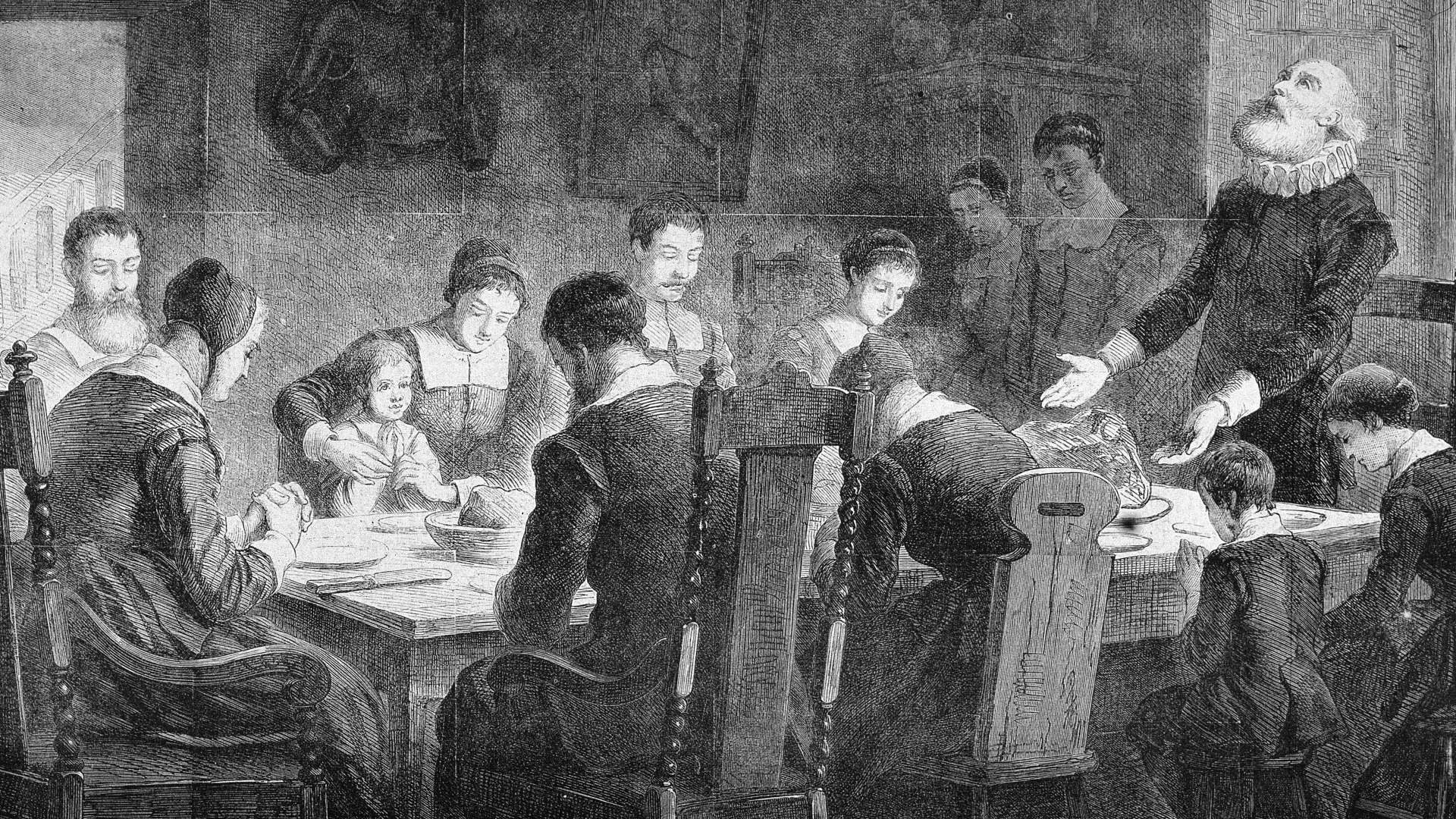 A man leading a blessing for Thanksgiving dinner, from an 1867 illustration. (Credit: Kean Collection/Getty Images)