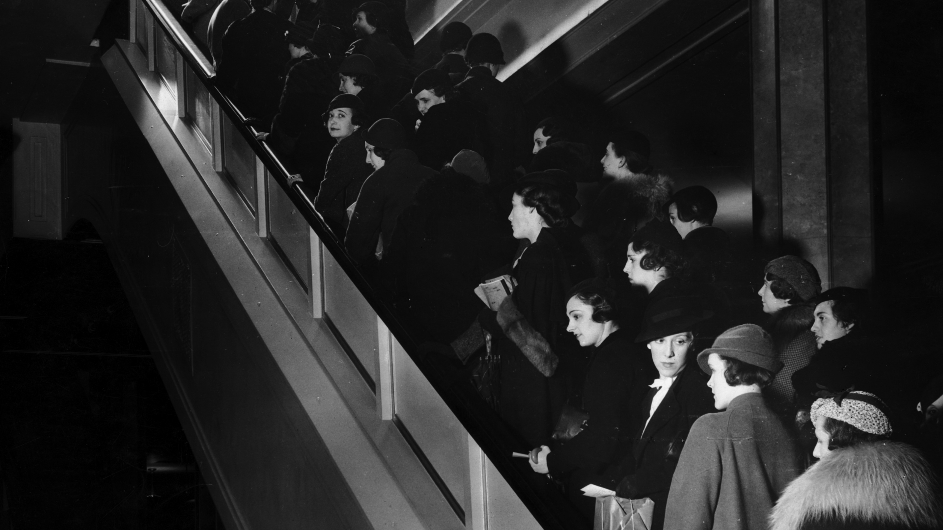 A crowd of shoppers on an escalator inside a department store in New York City, 1935. (Credit: Hulton Archive/Getty Images)