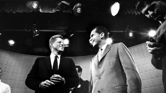 John F. Kennedy and Richard Nixon exchanging smiles prior to beginning their 1st TV debate. (Credit: Paul Schutzer/The LIFE Picture Collection/Getty Images)