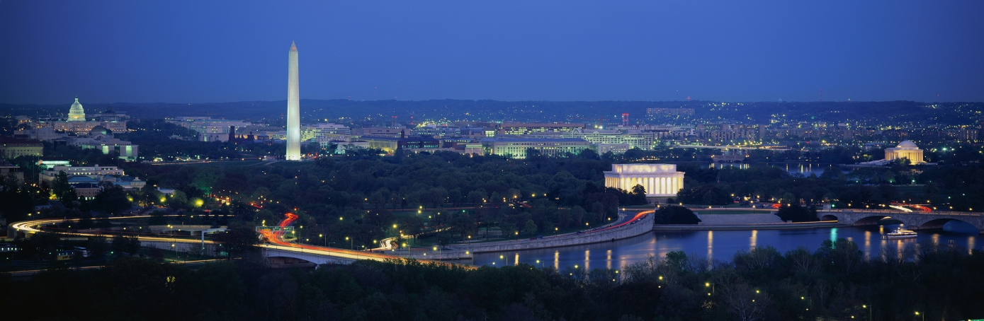 An aerial view of Washington D.C. showing illuminated buildings such as the US Capitol, Washington Monument, Lincoln Memorial, and the Jefferson Memorial. (Credit: Joseph Sohm; Visions of America/Getty Images)