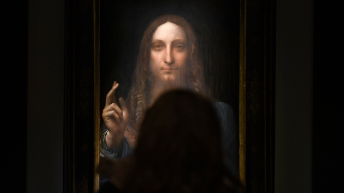 Leonardo da Vinci's 'Salvator Mundi' on display at Christie's New York during a press preview, 2017. (Credit: Timothy A. Clary/AFP/Getty Images)
