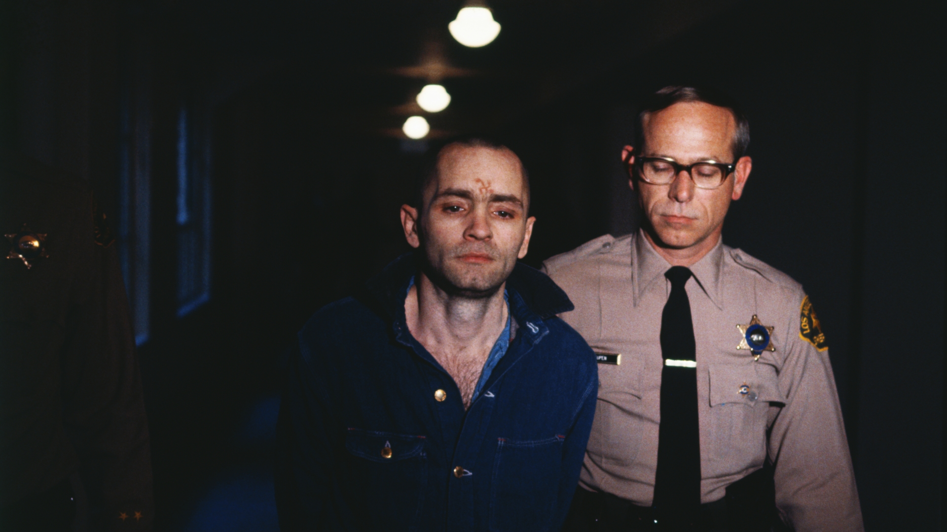 Charles Manson being led back into the courtroom to hear the penalty he and this three female followers must pay for the Tate-LaBianca murders of August 1969. (Credit: Bettmann Archive/Getty Images)