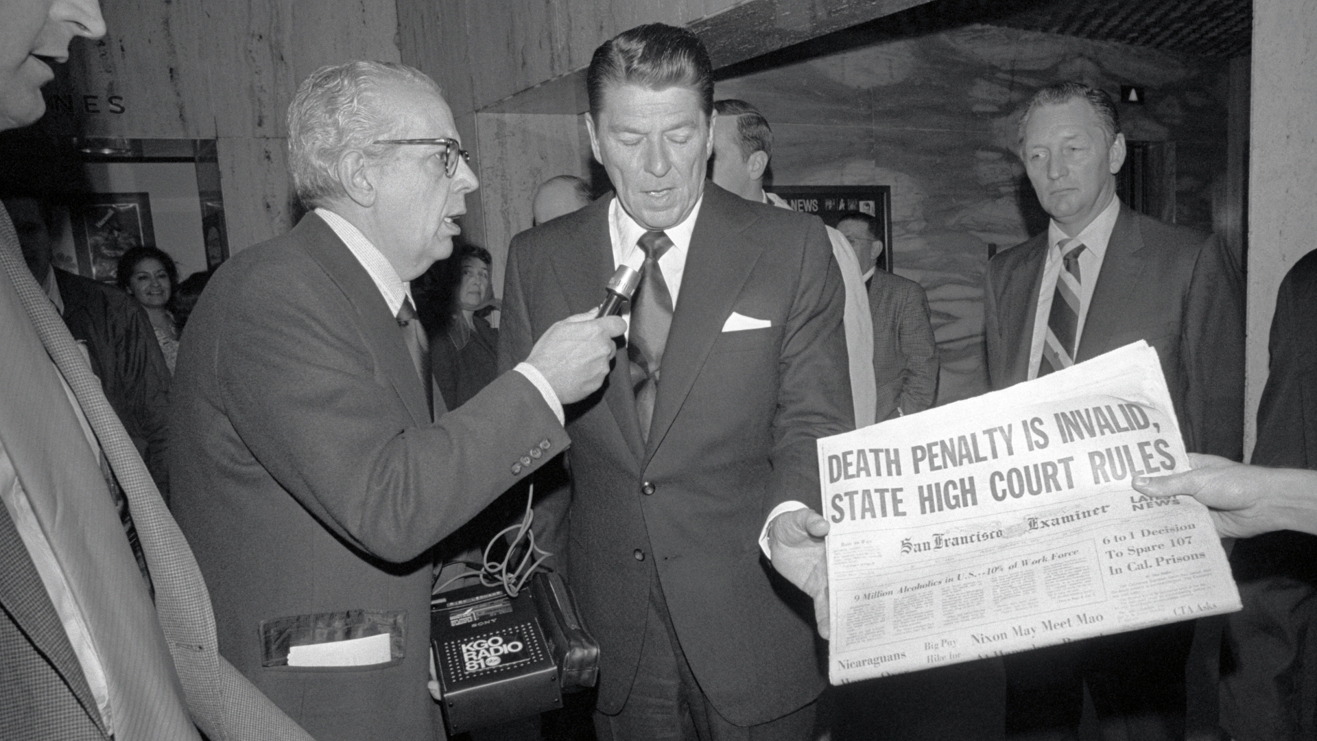 Ronald Reagan, then California's governor who was opposed to the abolition of the death penalty, being interviewed after looking at newspaper account of the State Supreme Court decision that the death penalty is unconstitutional, 1972. (Credit: Bettmann Archive/Getty Images)