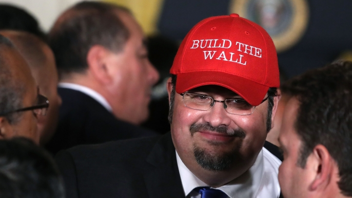 "Fredy Burgos of Virginia wears a hat with the words ""Build The Wall"" during an event to celebrate Hispanic Hertitage Month at the White House, October 6, 2017. (Credit: Mark Wilson/Getty Images)"