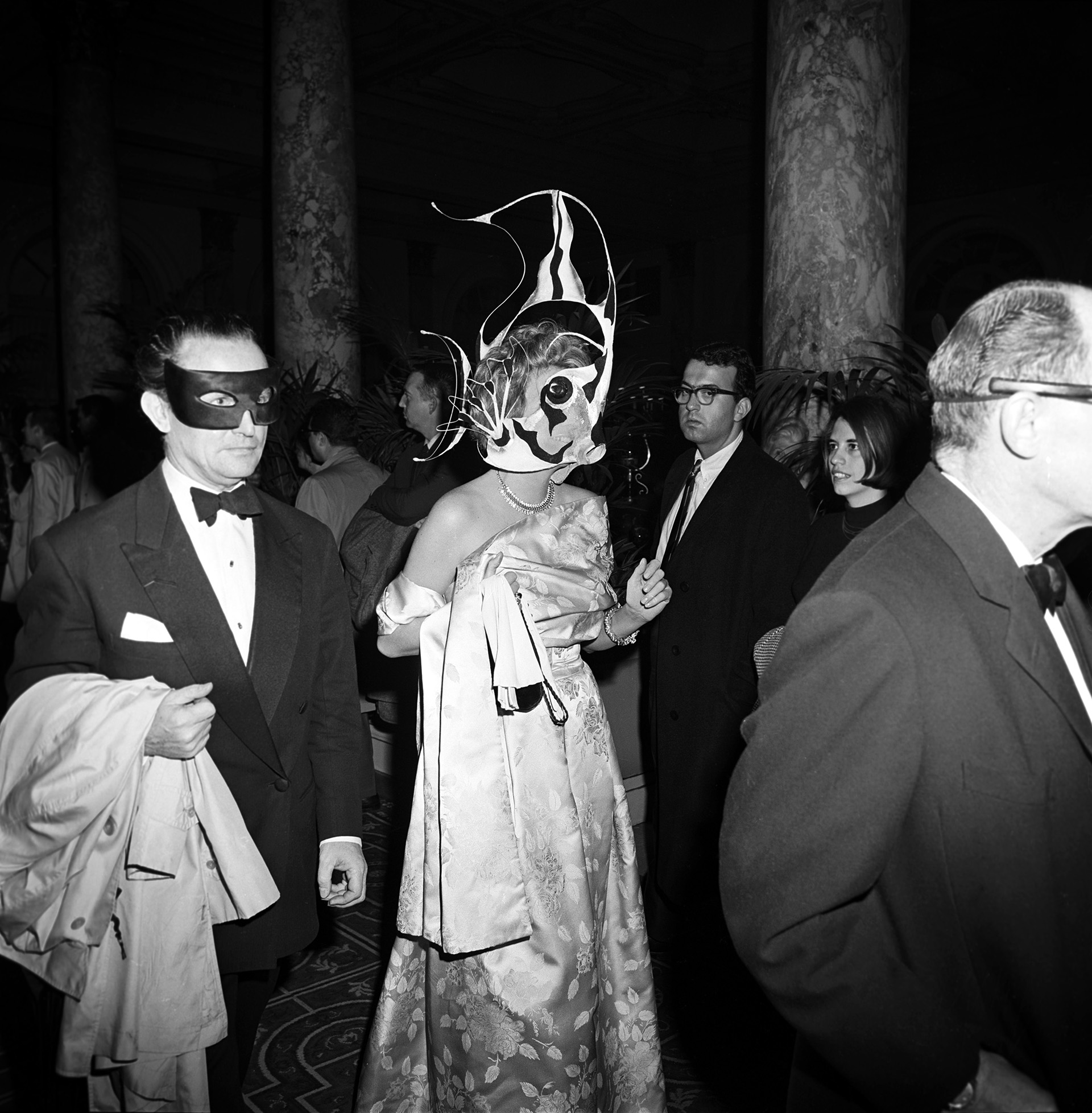 A couple in masks arriving at Truman Capote's Black and White Ball in the Grand Ballroom at the Plaza Hotel in New York City, 1966. (Credit: Morrison Ray ''Scotty/Penske Media/REX/Shutterstock)