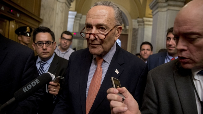 "Senator Chuck Schumer of New York speaking with reporters as he leaves Capitol Hill in Washington, just after Trump tweeted that the driver in the October 31, 2017 New York attack ""came into our country through what is called the 'Diversity Visa Lottery Program,' a Chuck Schumer beauty"". (Credit: AP/REX/Shutterstock)"
