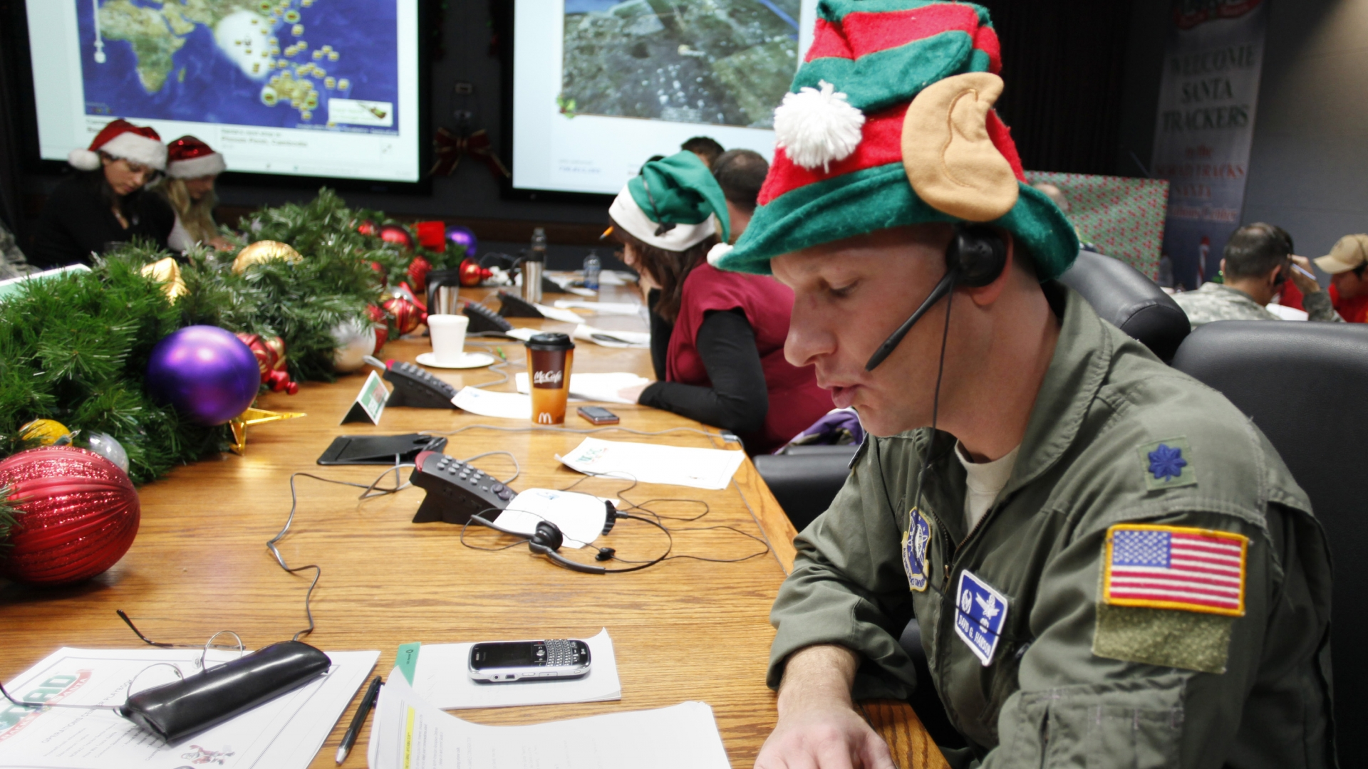 Air Force Lt. Col. David Hanson of Chicago taking a phone call from a child in Florida at the Santa Tracking Operations Center at Peterson Air Force Base near Colorado Springs. (Credit: Ed Andrieski/AP Photo)