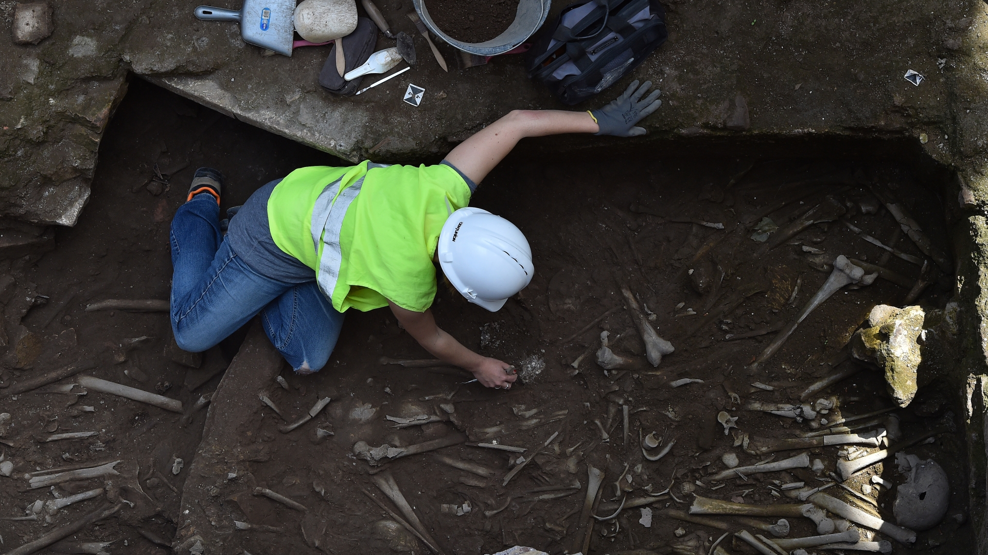 Archaeologists found a collective grave, where they have so far discovered 13 adult skeletons along with a bronze coin and a bronze bracelet. Officials hope to incorporate the discovery into the new metro station, which is scheduled to open in 2020. (Credit: Eric Vandeville/Sipa USA/AP Photo)