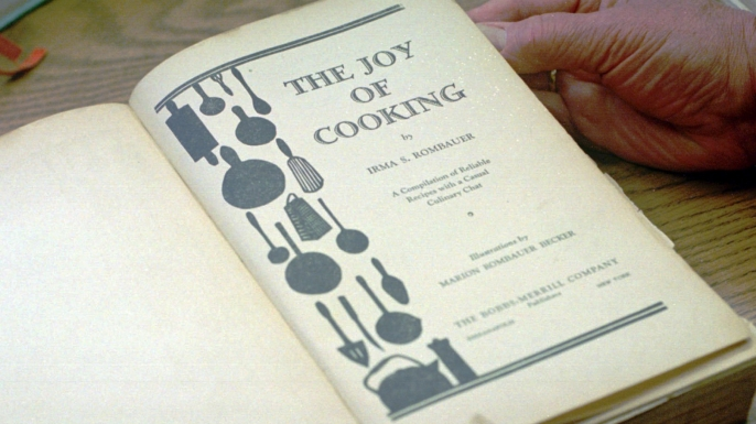"""An original 1931 edition of """"The Joy of Cooking"""" cookbook, written by Irma S. Rombauer and her daughter Marion Rombauer Becker, at the Schlesinger Library at Radcliffe College. (Credit: Gail Oskin/AP Photo)"""