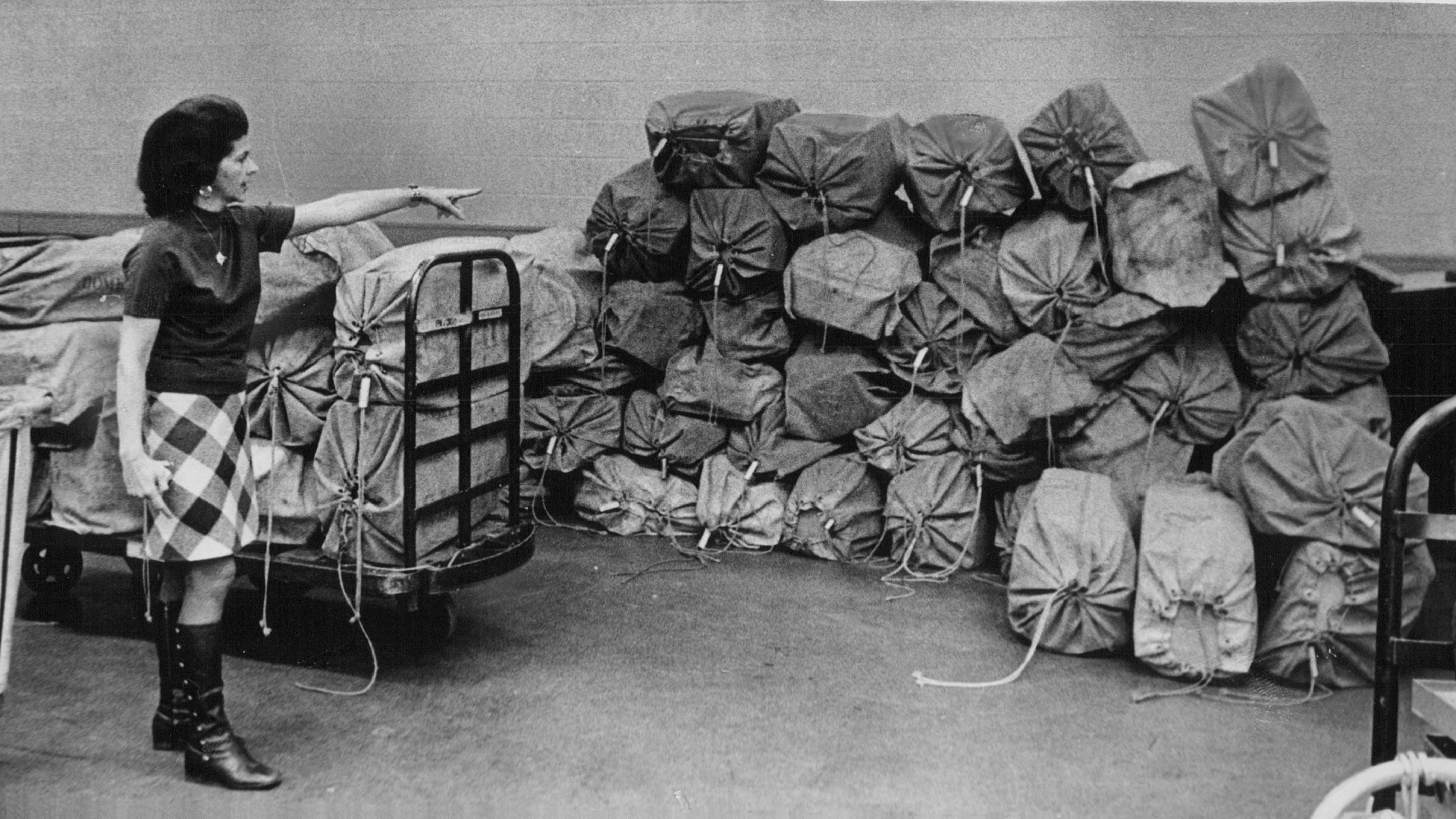 Martha Leslie, Secretary to Operations Director, points to 60 bags of parcel post stalled in Denver due to the postal strike. (Credit: Dave Buresh/The Denver Post via Getty Images)