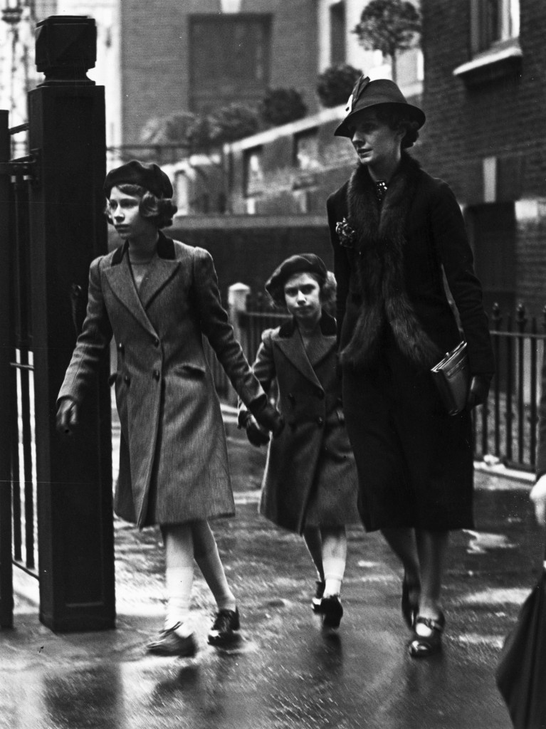 Princess Elizabeth and her sister Princess Margaret accompanied by Miss Marion Crawford leaving the headquarters of the YWCA (Young Women's Christian Association) in London, May 1939. (Credit: Stephenson/Topical Press Agency/Getty Images)