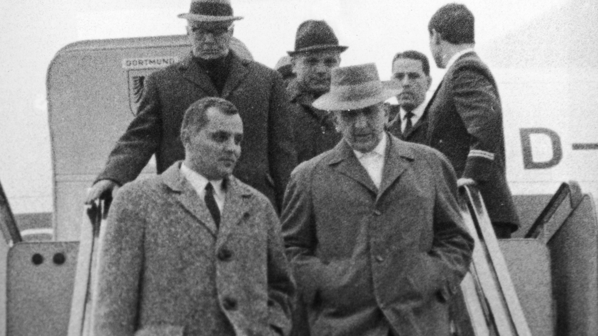 Gerhard Bohne (right) arriving at Frankfurt Airport from Buenos Aires, accompanied by two officials of the district criminal board of Wiesbaden. Bohne would be prosecuted for administering the Nazi's euthanasia program aimed at purifying the Aryan race of people with physical infirmities and mental disabilities. (Credit: Keystone/Getty Images)