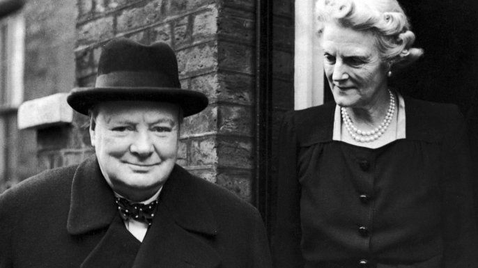 On his 71st birthday, former British Prime Minister Winston Churchill and his wife Clementine leaving their home at Hyde Park Gate, to attend a commons debate, 1945. (Credit: Keystone/Hulton Archive/Getty Images)