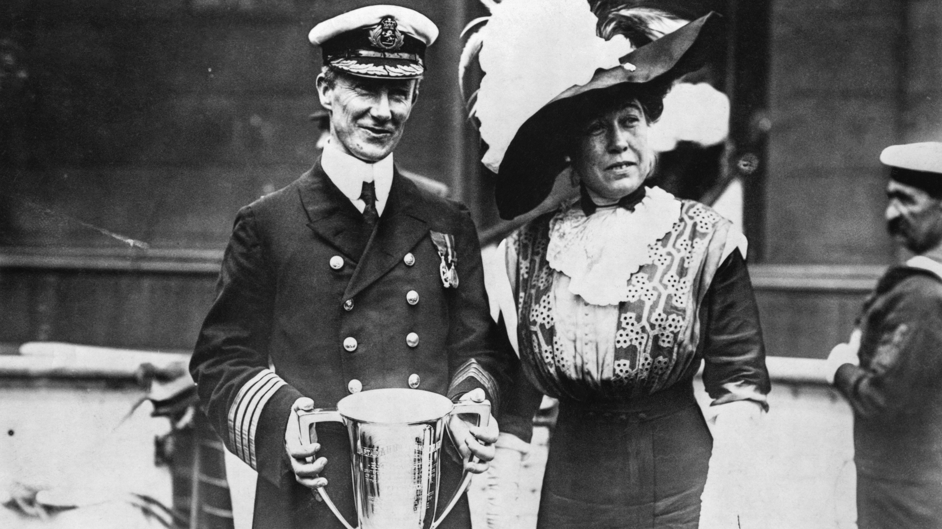 Titanic survivor Margaret Brown alongside Captain Arthur Rostron, of the RMS Carpathia, who was awarded a silver cup for rescuing survivors of the shipwrecked Titanic. (Credit: DeAgostini/Getty Images)