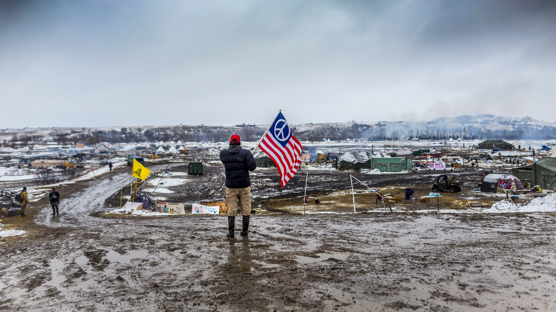 Defiant Dakota Access Pipeline water protectors faced-off with various law enforcement agencies on the day the camp was slated to be raided. Many protesters and independent journalist, who were all threatened with multiple felony charges if they didn't leave were met with militarized police on the road abutting the camp. (Credit: Michael Nigro/Pacific Press/LightRocket via Getty Images)