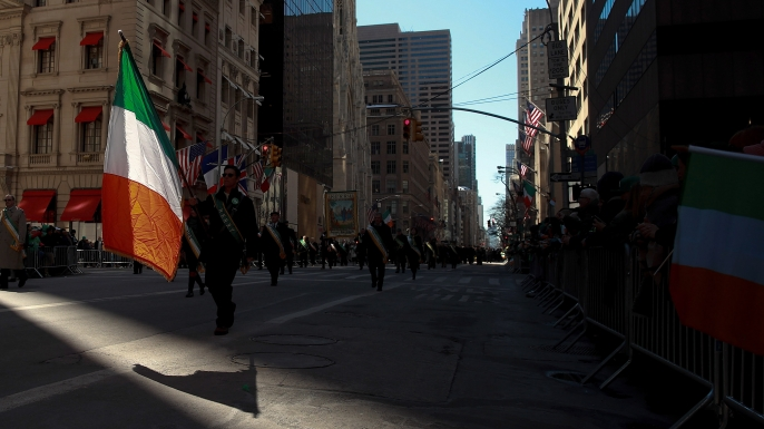 A participant of the annual St. Patrick's Day parade in New York City, which dates back to 1762, marches down 5th Avenue with an Irish flag. (Credit: Drew Angerer/Getty Images)