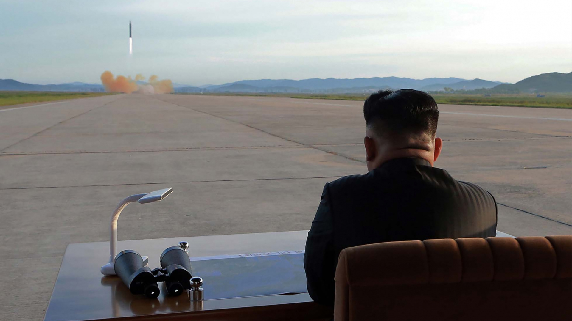 An undated picture released from North Korea's official Korean Central News Agency on September 16, 2017 shows North Korean leader Kim Jong-Un inspecting a launching drill of the medium-and-long range strategic ballistic rocket Hwasong-12 at an undisclosed location. (Credit: STR/AFP/Getty Images)