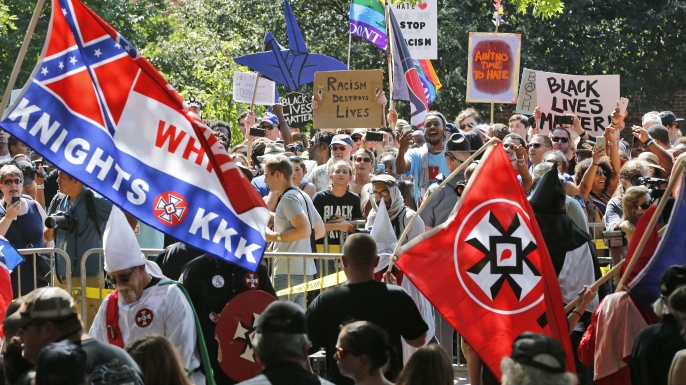 A large group of protesters demonstrate against a KKK rally in Justice Park, in Charlottesville, Virginia, 2017. (Credit: AP/REX/Shutterstock)