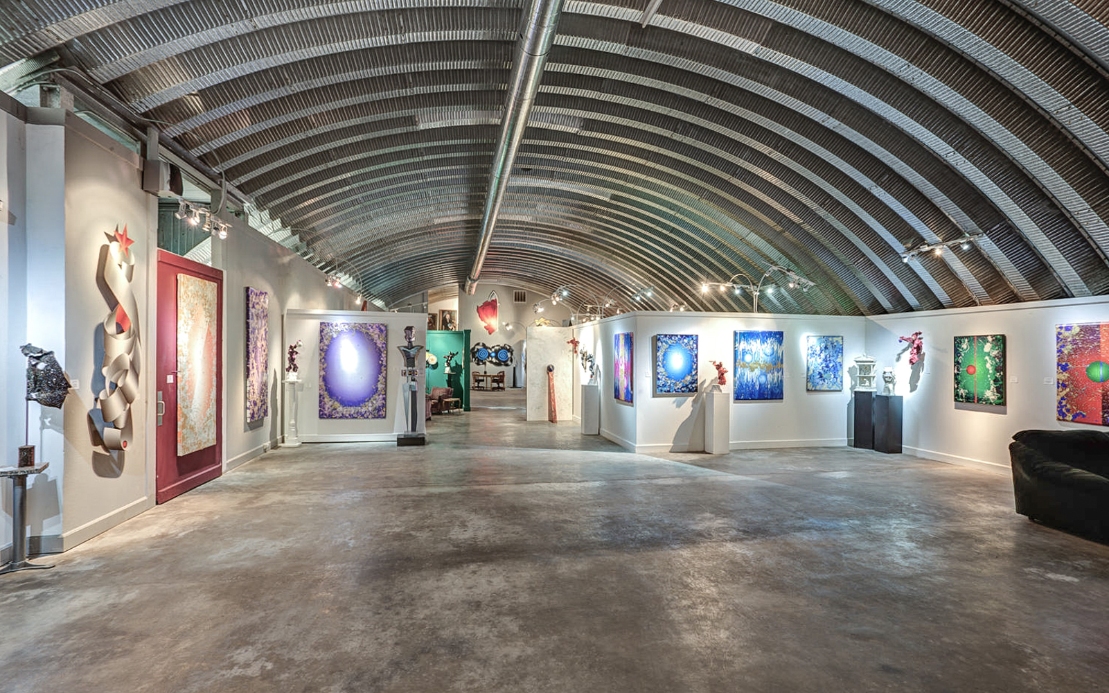 Beninis transformed the 12,000-square-foot hangar on the property into an art gallery. (Image courtesy of Coldwell Banker)
