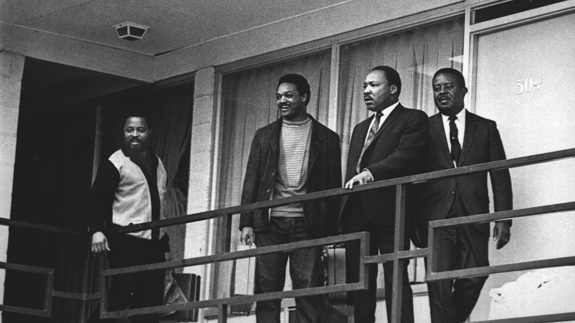 Martin Luther King Jr. standing with other civil rights leaders on the balcony of the Lorraine Motel in Memphis, Tennessee, a day before he was assassinated at approximately the same place in April, 1968. (Credit: Charles Kelly/AP Photo)