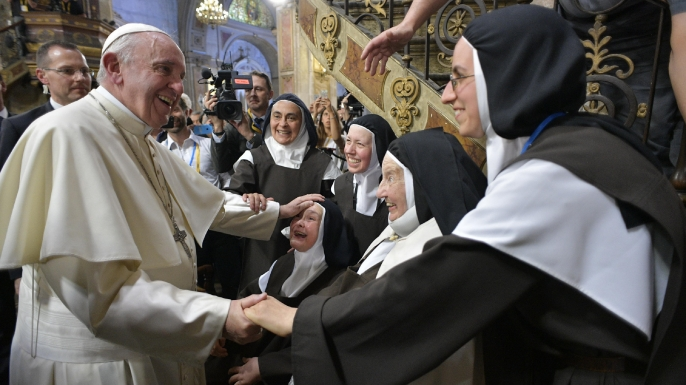 Pope Francis being cheered for by nuns upon his arrival at the Cathedral, in Santiago, Chile. (Credit: L'Osservatore Romano/Pool Photo Via AP Photo)