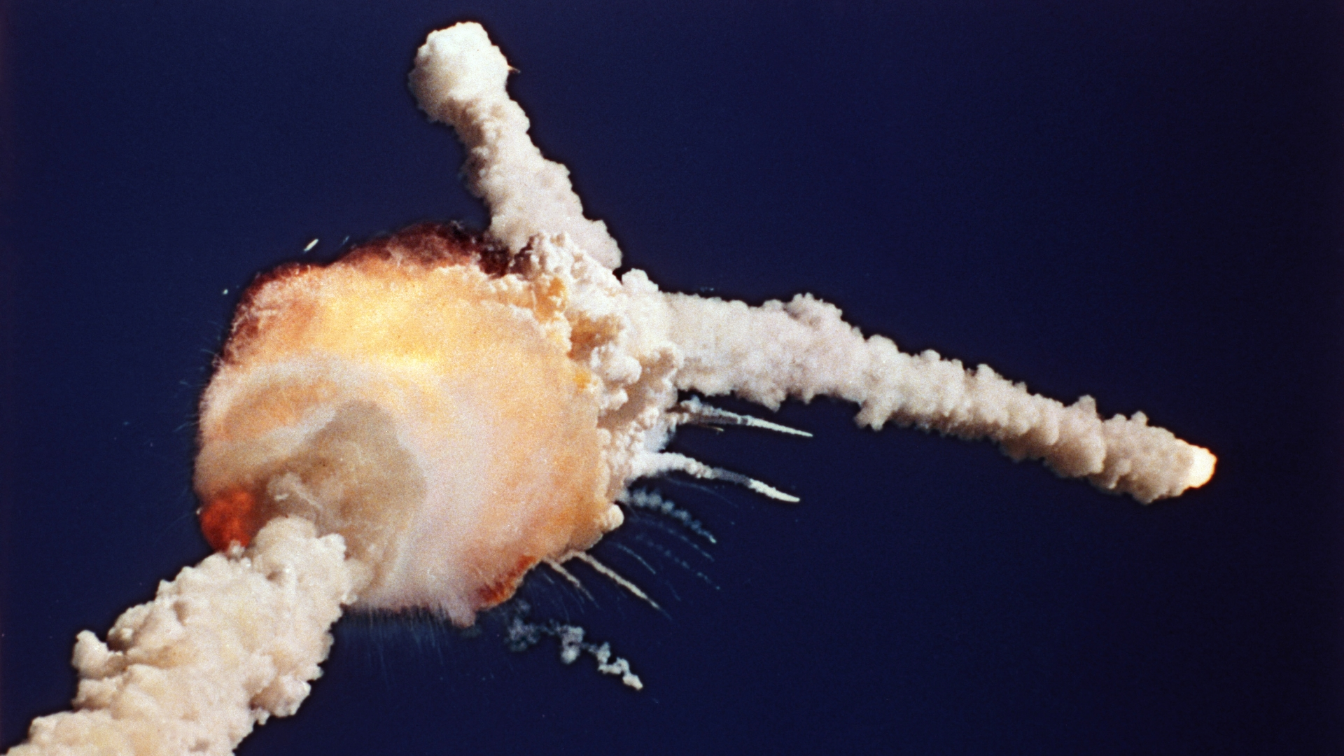 The space shuttle Challenger exploded 73 seconds after lift off. (Credit: Bruce Weaver/AP Photo)