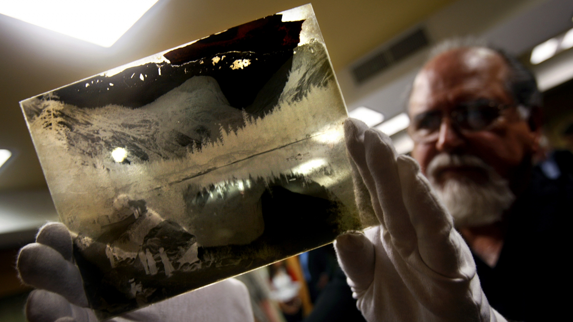 Rick Norsigian holding a Ansel Adams glass negative depicting Mirror Lake in Yosemite National Park. (Credit: Eric Paul Zamora/Fresno Bee/MCT via Getty Images)