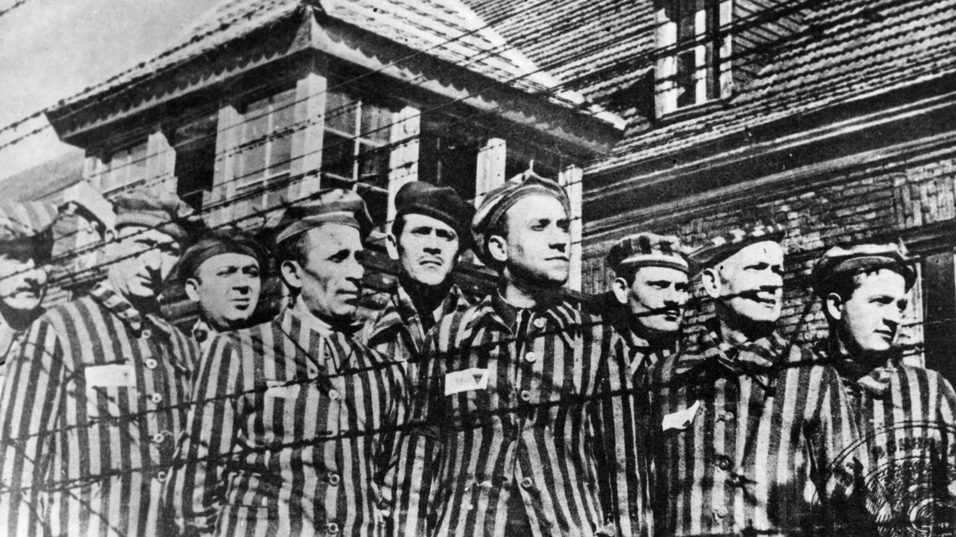 Some of the few surviving prisoners of Auschwitz concentration camp in Poland, 1945. (Credit: Sovfoto/UIG via Getty Images)