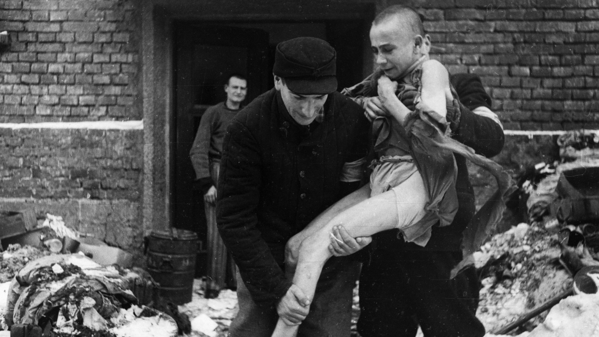 A 15 year old Russian boy, Ivan Dudnik, being rescued from Auschwitz. (Credit: Sovfoto/UIG via Getty Images)