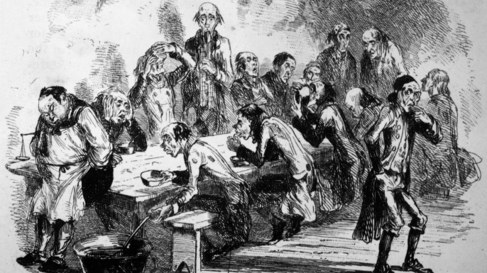 Men sitting down to dinner in the poorhouse, 1840. (Credit: Hulton Archive/Getty Images)